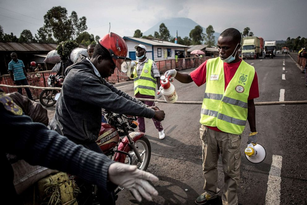 PHOTO: A driver gets his hands washed at an Ebola screening station on the road between Butembo and Goma, July 16, 2019 in the Democratic Republic of Congo.
