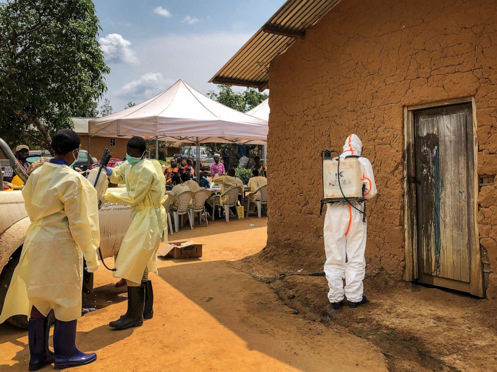 PHOTO: A worker from the World Health Organization decontaminates the doorway of a house on a plot where two cases of Ebola were found, in the village of Mabalako, in eastern Congo Monday, June 17, 2019.