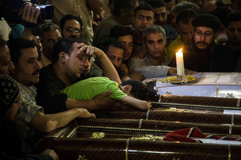 Christians in Egypt prepare to bury dead a day after attack
