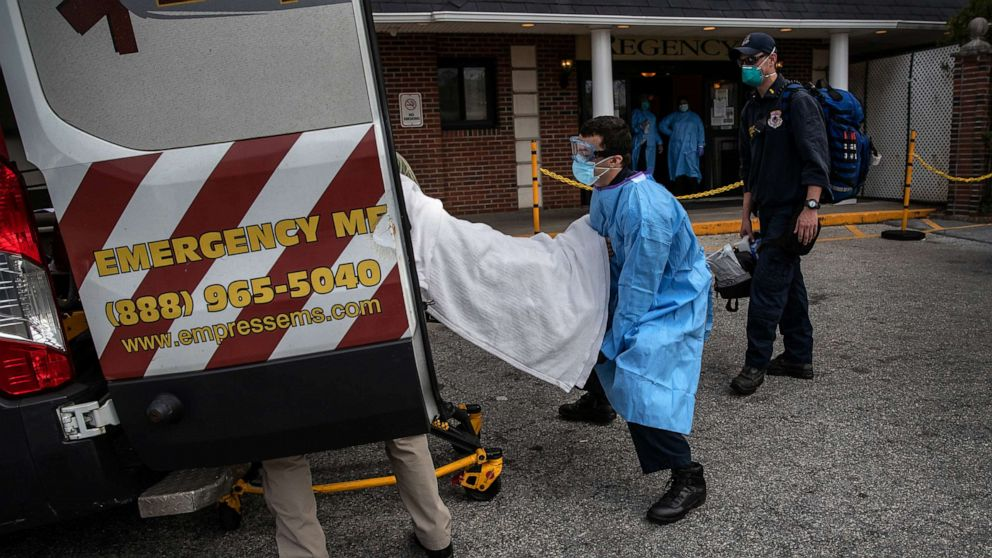 A medic from Empress EMS loads a suspected COVID-19 patient from the Regency Extended Care Center into an ambulance, April 7, 2020, in Yonkers, New York.John Moore/Getty Images
