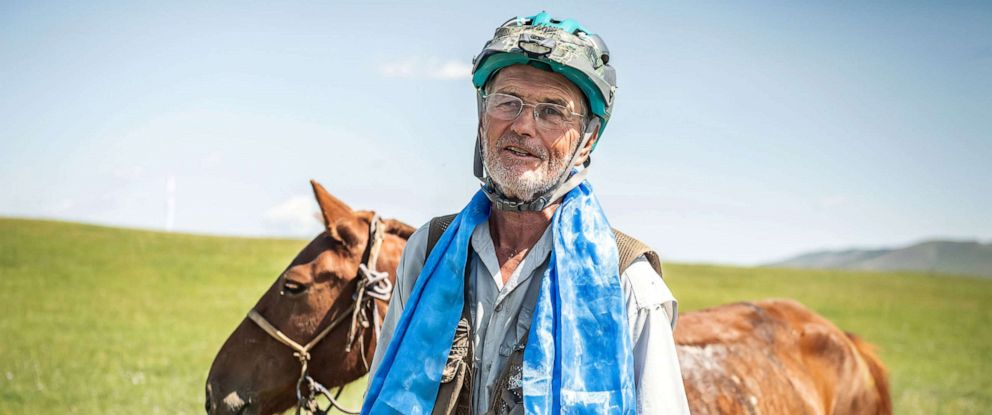 PHOTO: Robert Long, known by the nickname Cowboy Bob, who is the oldest winner of Mongol Derby, the 1,000 km worlds longest horse race,poses with his horse near Jargalt, Mongolia, Aug. 14, 2019.
