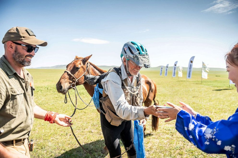 PHOTO: Robert Long, known by the nickname Cowboy Bob, who is the oldest winner of Mongol Derby, the 1,000 km worlds longest horse race, is pictured with his horse near Jargalt, Mongolia, Aug. 14, 2019.