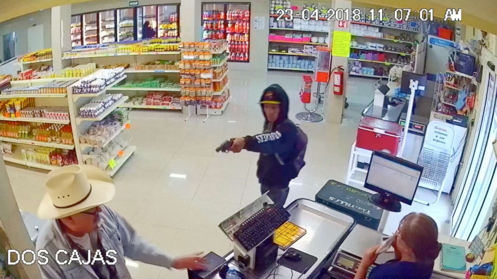 Man wearing cowboy hat tackles armed robber at butcher shop in Mexico.