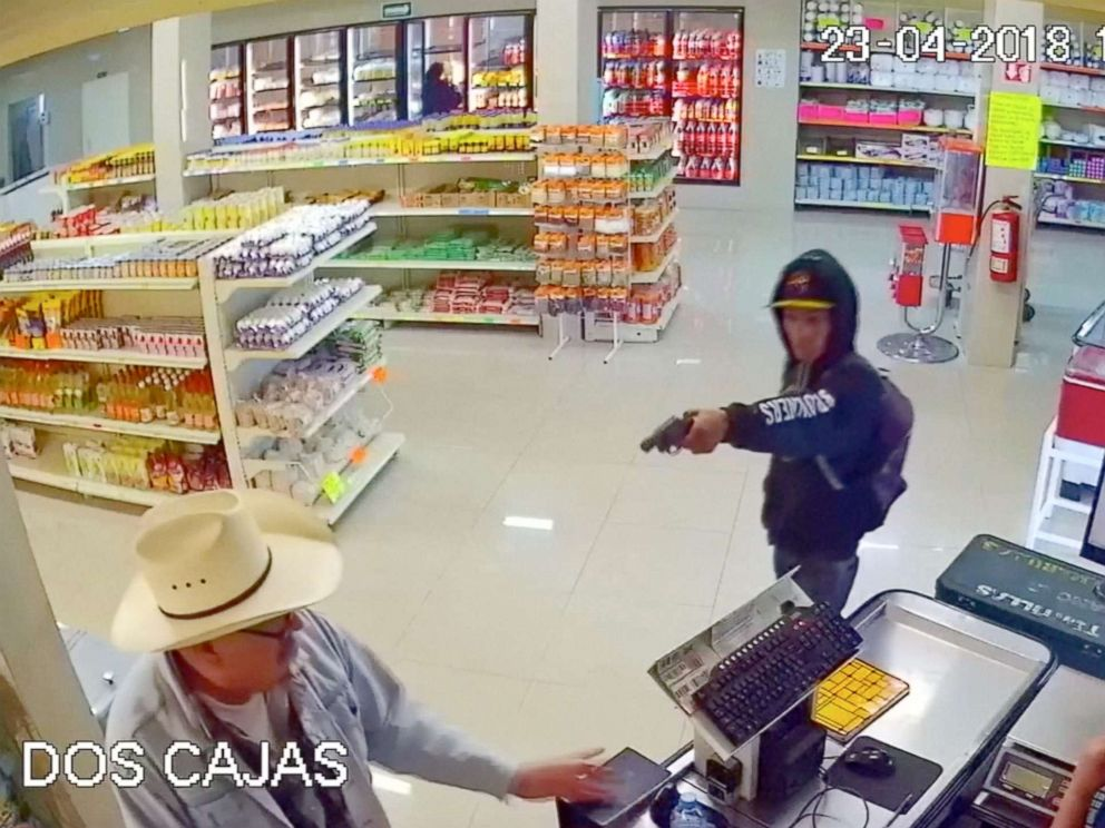 PHOTO: Man wearing cowboy hat tackles armed robber at butcher shop in Mexico.