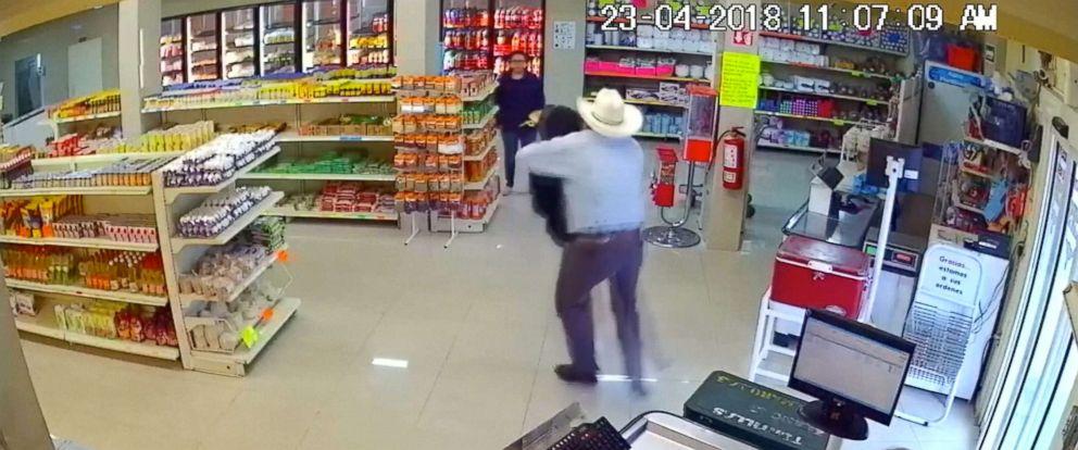 PHOTO: Good Samaritan wearing cowboy hat tackles armed robber at butcher shop in Mexico.