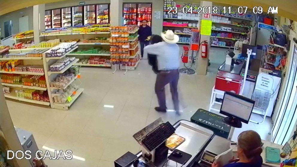 Good Samaritan wearing cowboy hat tackles armed robber at butcher shop in Mexico.