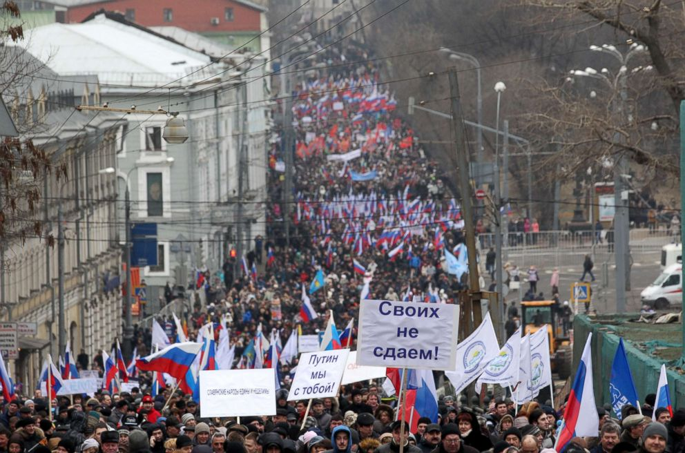 PHOTO: People attend a rally to support Russian President Vladimir Putin with the invasion of Crimea, March 2, 2014, in Moscow.
