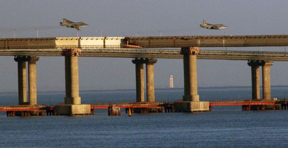 PHOTO: Russian jet fighters fly over a bridge connecting the Russian mainland with the Crimean Peninsula after three Ukrainian navy vessels were stopped by Russia from entering the Sea of Azov via the Kerch Strait in the Black Sea, Crimea, Nov. 25, 2018.