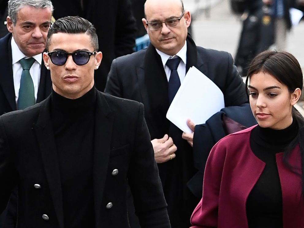 PHOTO: Juventus forward and former Real Madrid player Cristiano Ronaldo arrives with his girlfriend Georgina Rodriguez to attend a court hearing for tax evasion in Madrid Jan. 22, 2019.