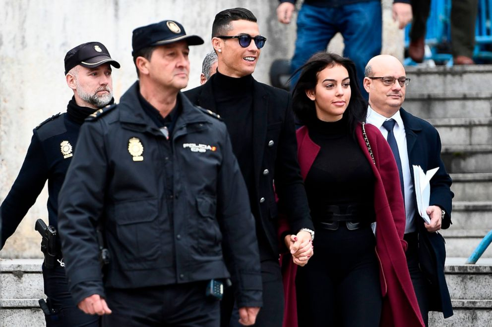 Juventus' forward and former Real Madrid player Cristiano Ronaldo leaves with his girlfriend Georgina Rodriguez to after a court hearing for tax evasion in Madrid Jan. 22, 2019.
