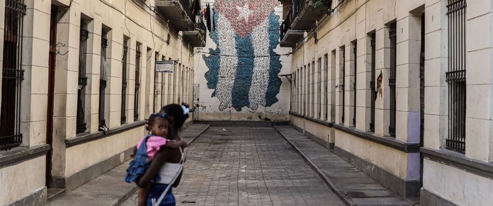 PHOTO: A young woman and a child walk down a street in Havana, Cuba, July 13, 2019.