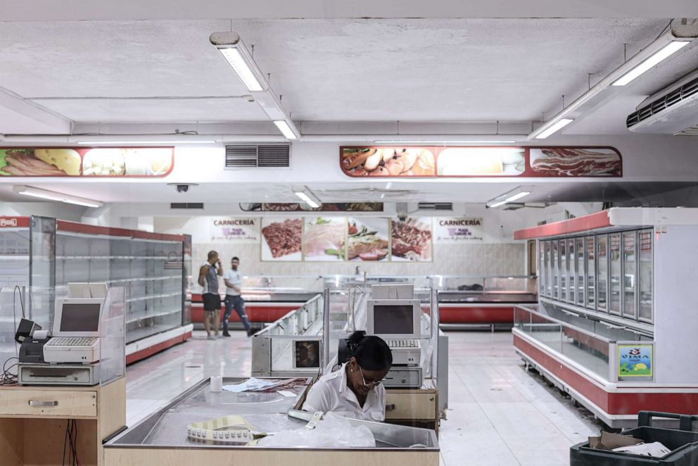 PHOTO: Empty shelves of a government owned grocery store are seen on July 13, 2019 in Havana, Cuba. Meat and fish are hard to find for some locals because of embargoes, production problems and big tourist hotels taking first priority on products.