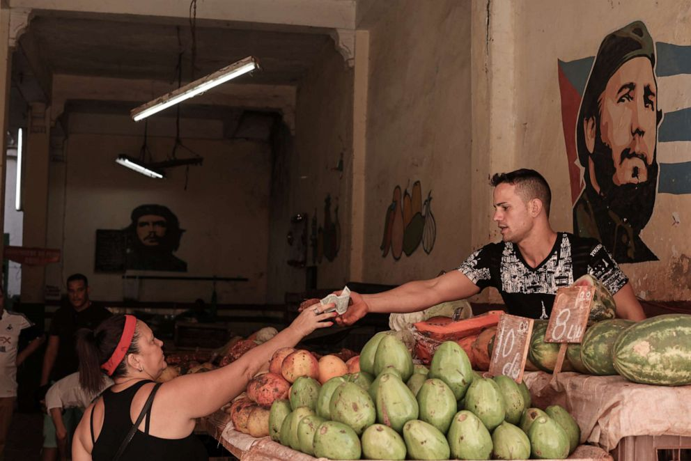 PHOTO: A woman buys fruit in Havana, Cuba, July 13, 2019. The revolutionary system set up after the war in 1959 is no longer able to cope with the new embargo sanctions and the changing world.