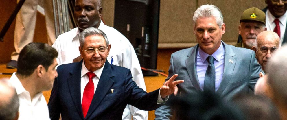 PHOTO: Cuban President Raul Castro (L) and First Vice-President Miguel Diaz-Canel (C) arrive for a National Assembly session that named the latter as the candidate to succeed Castro as president, in Havana, April 18, 2018.