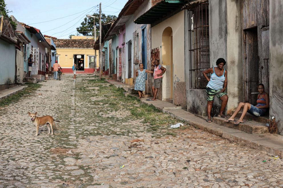 PHOTO: Residents stand on a street in Trinidad, Sancti Spiritus, Cuba, July 5, 2019. Cubas already fractured economic and social system has been hit by harsh new US sanctions recently targeting its main source of money: the tourist industry.