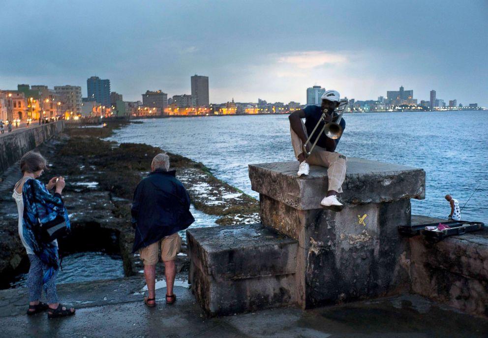 PHOTO: Musician Lazaro Martinez plays his trombone on the Malecon sea wall in Havana, Cuba, April 13, 2018.