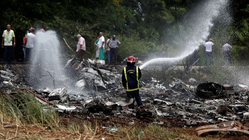 A firefighter works in the wreckage of a Boeing 737 plane that crashed in the agricultural area of Boyeros, around 20 km (12 miles) south of Havana, shortly after taking off from Havana's main airport in Cuba, May 18, 2018.