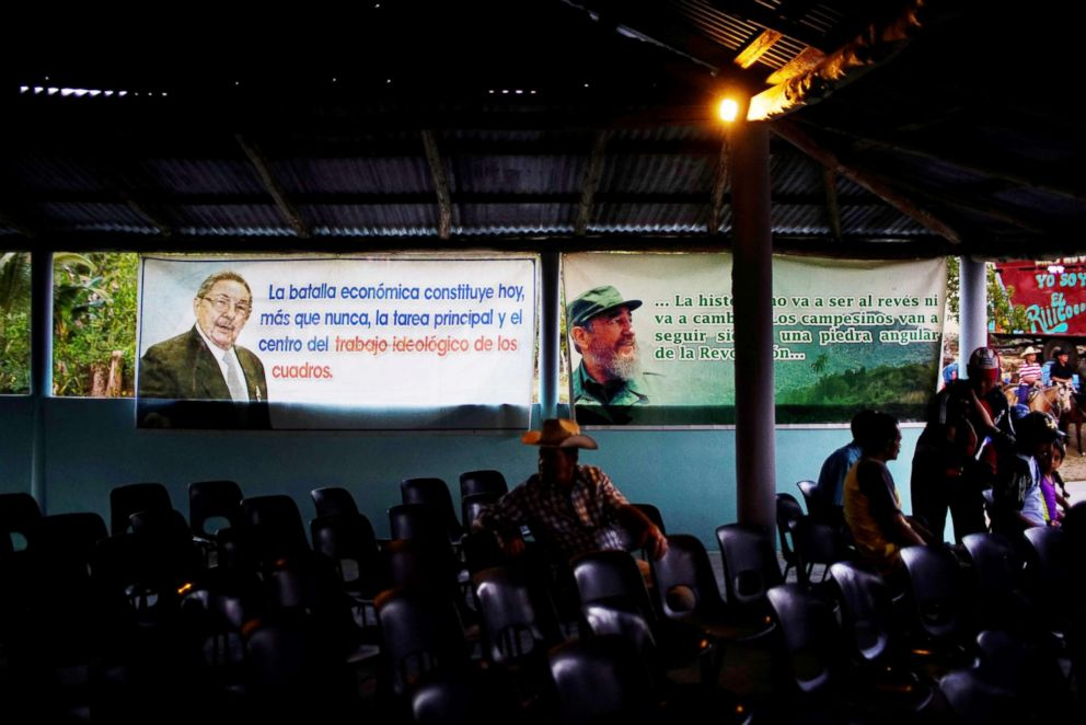 PHOTO: Images of Cuban President Raul Castro and late Cuban President Fidel Castro are displayed inside a community center during the recording of an episode of the popular TV show Palmas y Canas in the village of Providencia, March 29, 2018.