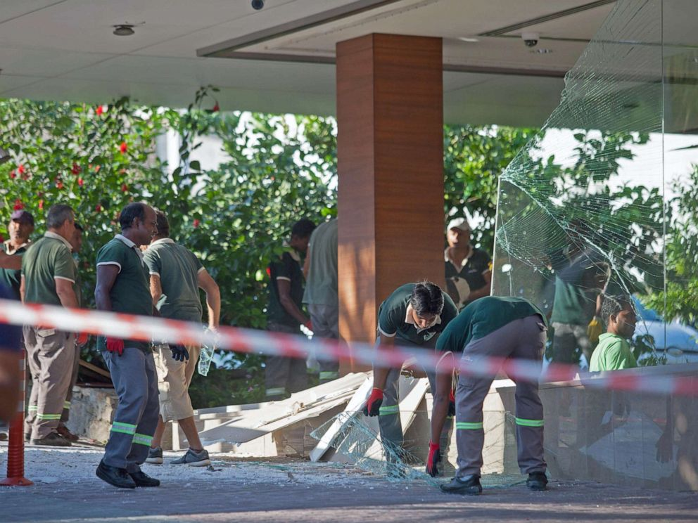PHOTO: Workers at Acapulco hotel in Kyrenia, Cyprus assess the damage after a military depot exploded nearby, on Sept. 12, 2019.