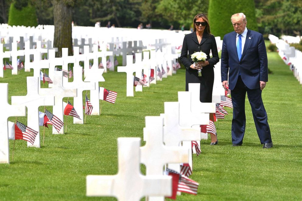 PHOTO: President Donald Trump and First Lady Melania Trump visit graves after a French-U.S. ceremony in Normandy, northwestern France, on June 6, 2019, as part of D-Day commemorations.