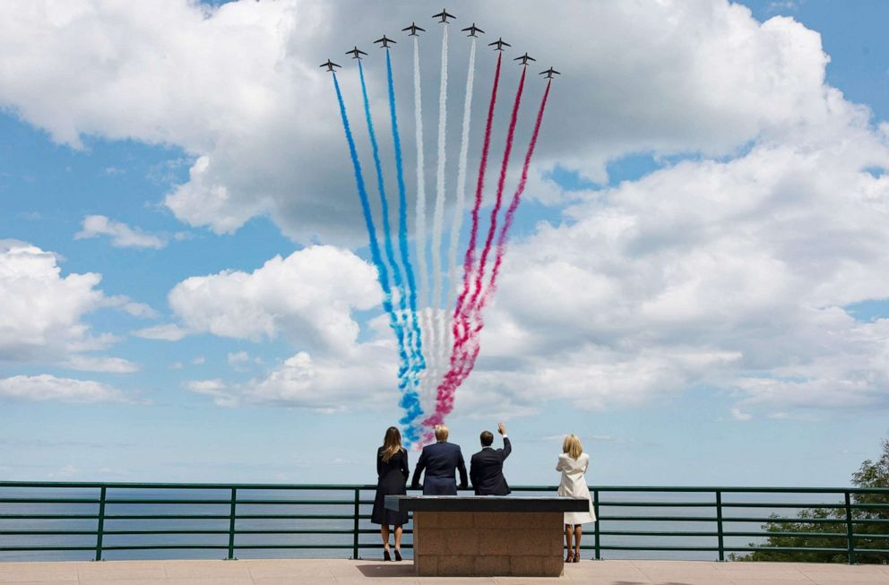 PHOTO: President Donald Trump, First Lady Melania Trump, French President Emmanuel Macron and his wife Brigitte Macron react during the commemoration marking the 75th anniversary of the Allied landings on D-Day in France, June 06, 2019.