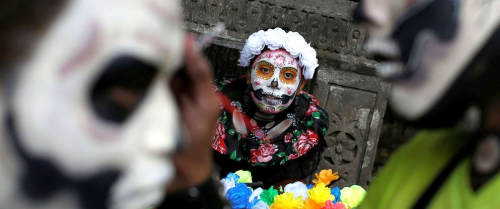 """PHOTO: A woman dressed up as """"Catrina,"""" a Mexican character also known as """"The Elegant Death,"""" takes part in a Catrinas parade in Mexico City, Oct. 22, 2017."""