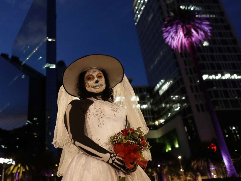 PHOTO: Montserrat Ramirez, dressed as a skeleton bride, poses for pictures during the Grand Procession of the Catrinas, part of upcoming Day of the Dead celebrations, in Mexico City, Oct. 22, 2017.