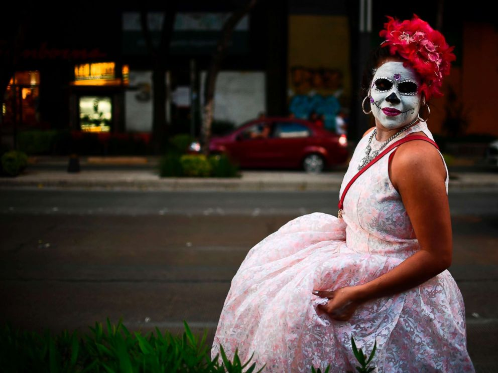 PHOTO: A person fancy dressed as Catrina takes part in the Catrinas Parade along Reforma Avenue, in Mexico City, Oct. 22, 2017.