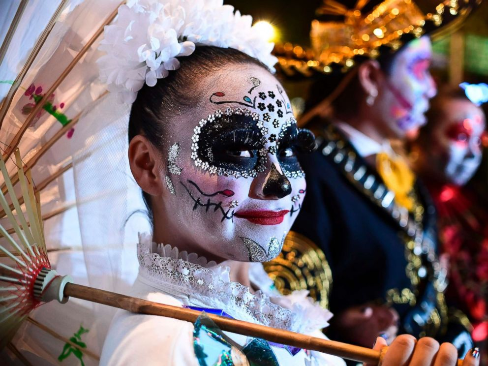 PHOTO: People fancy dressed as Catrina take part in the Catrinas Parade along Reforma Avenue, in Mexico City, Oct. 22, 2017.
