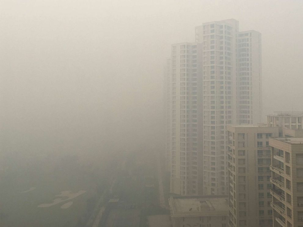 PHOTO: Residential buildings are seen in smog in Noida on the outskirts of New Delhi, India, Nov. 5, 2018.
