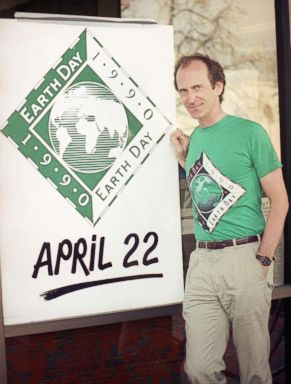 PHOTO: Earth Day founder Denis Hayes poses with an Earth Day sign outside Earth Day headquarters in Palo Alto, Calif., on April 21, 1990, in this file photo. Earth Day is set for April 22 with environmental activities planned throughout the world.