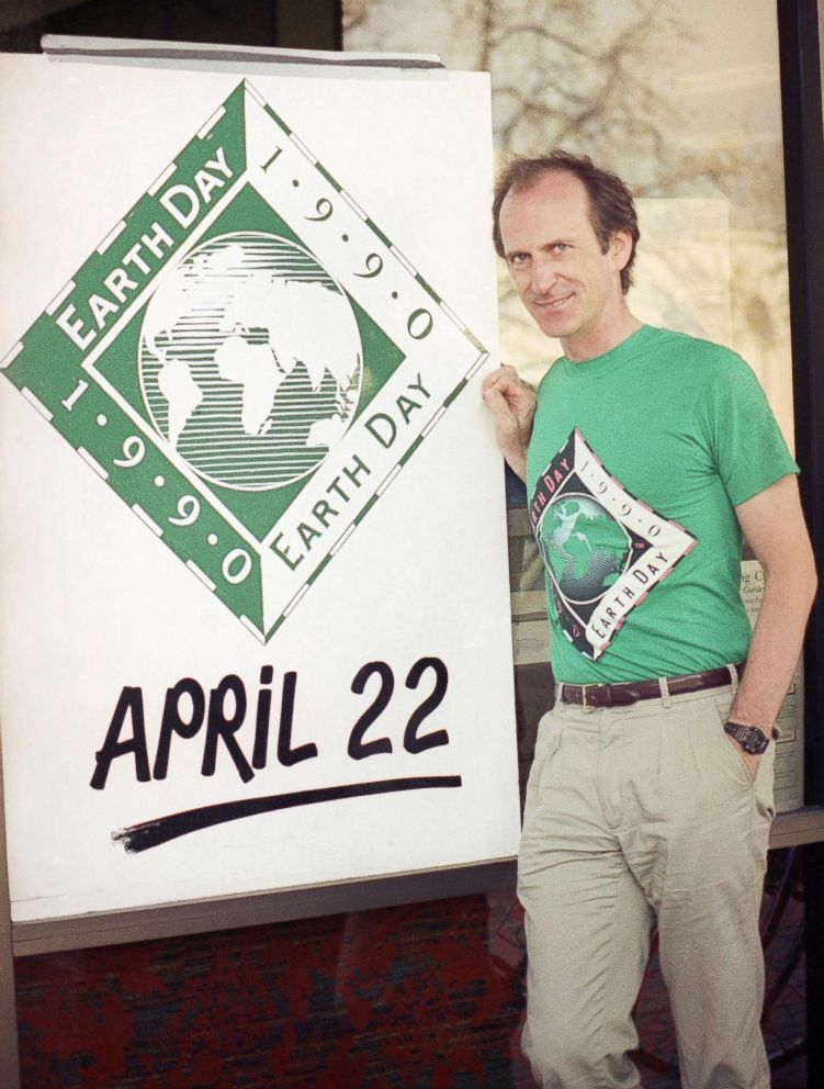 Earth Day founder Denis Hayes poses with an Earth Day sign outside Earth Day headquarters in Palo Alto, Calif., on April 21, 1990, in this file photo. Earth Day is set for April 22 with environmental activities planned throughout the world.