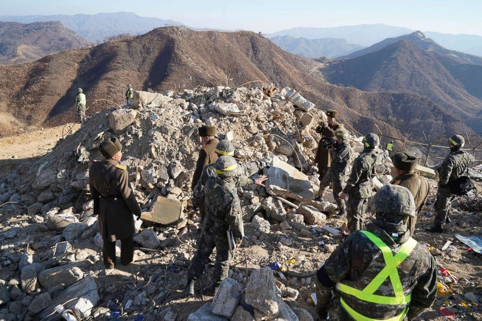 PHOTO: South Korean and North Korean army soldiers inspect a dismantled North Korean guard post inside the Demilitarized Zone (DMZ) in the central section of the inter-Korean border in Cheorwon, North Korea, Dec. 17, 2018.