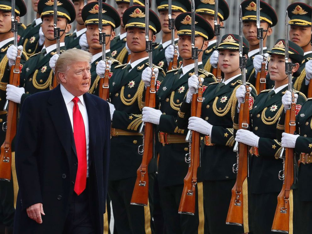 PHOTO: President Donald Trump reviews an honor guard during a welcome ceremony at the Great Hall of the people in Beijing, Nov. 9, 2017.