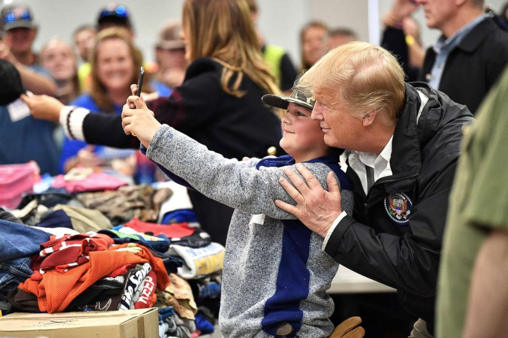 President Donald Trump greets residents in Opelika, Ala., March 8, 2019.