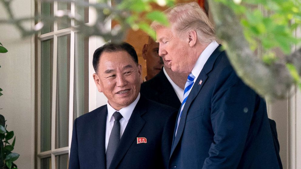 President Donald Trump talks with Kim Yong Chol, former North Korean military intelligence chief and one of leader Kim Jong Un's closest aides, as they walk from their meeting in the Oval Office of the White House in Washington, D.C., June 1, 2018.
