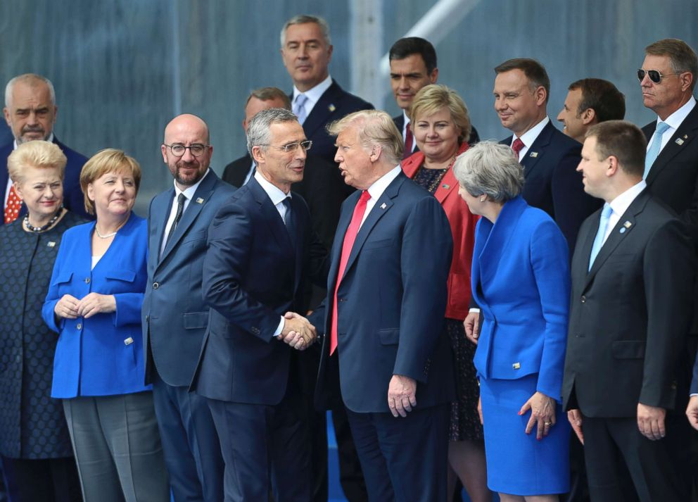 PHOTO: NATO Secretary General Jens Stoltenberg (center L) shakes hands with President Donald Trump during a NATO summit in Brussels, July 11, 2018.