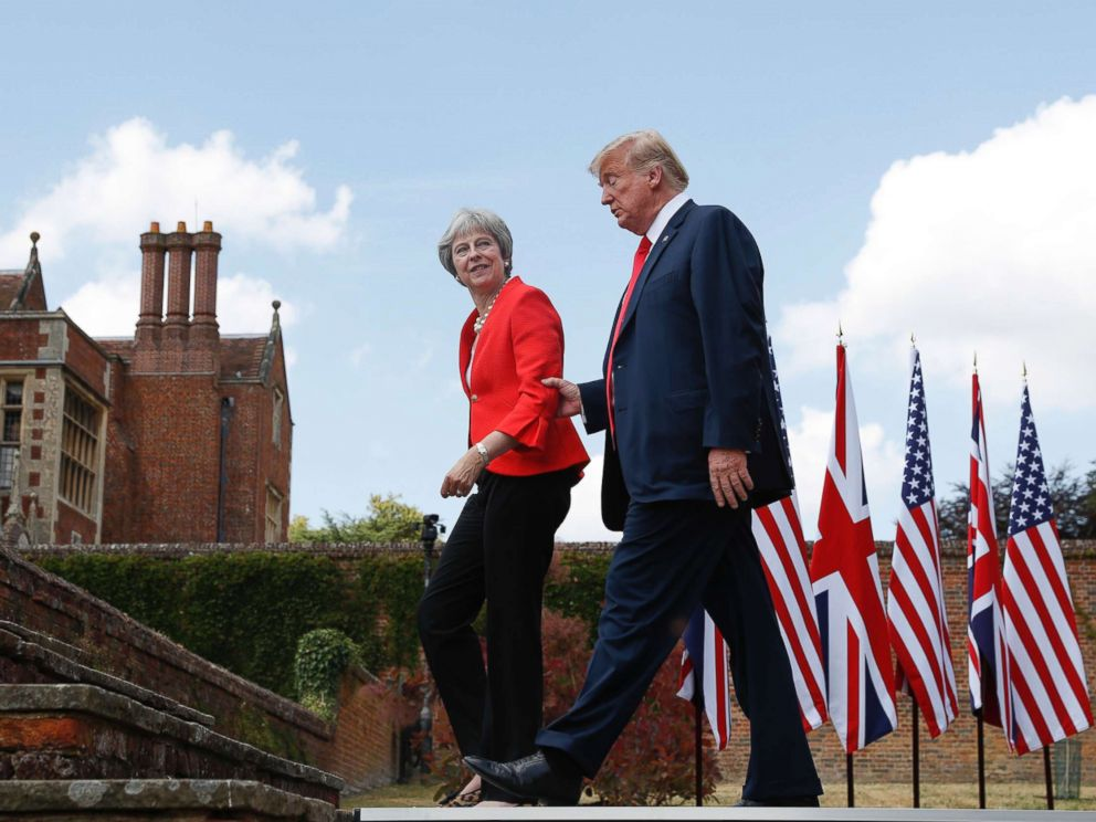 PHOTO: President Donald Trump walks with British Prime Minister Theresa May at the conclusion of their joint news conference at Chequers, in Buckinghamshire, England, July 13, 2018.