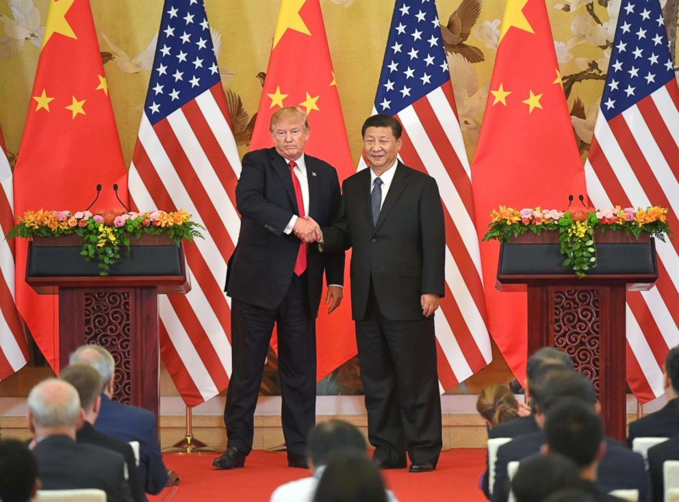PHOTO: President Donald Trump and Chinese President Xi Jinping shake hands at a joint press conference after their meeting in Beijing on November 9, 2017.