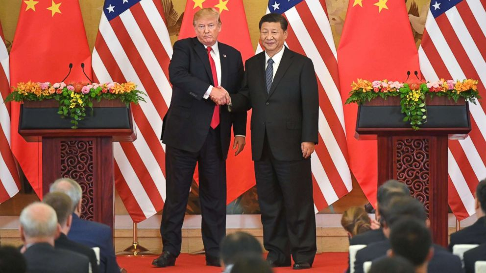President Donald Trump and Chinese President Xi Jinping shake hands at a joint news conference held after their meeting in Beijing on Nov. 9, 2017. The two leaders agreed to keep enforcing U.N. sanctions on North Korea until it rids itself of nuclear weapons while pledging to address the billowing U.S. trade deficit with China.