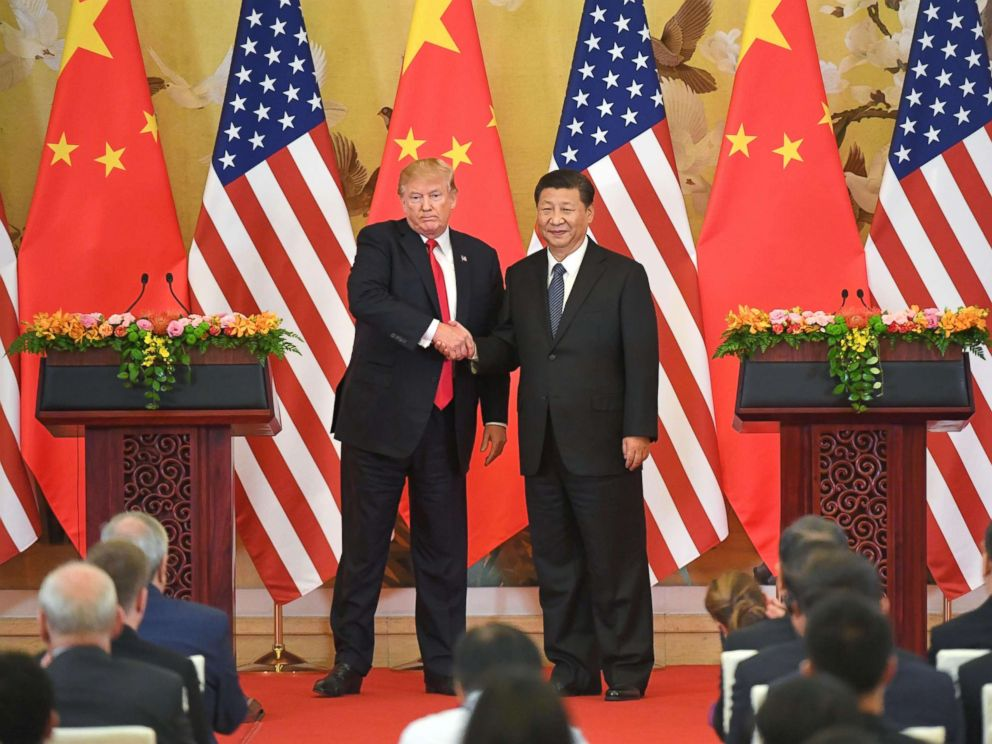 PHOTO: President Donald Trump and Chinese President Xi Jinping shake hands at a joint news conference held after their meeting in Beijing on Nov. 9, 2017.  China hints it may retaliate against US for new tariffs donald trump xi jinping gty mem 180619 hpMain 4x3 992