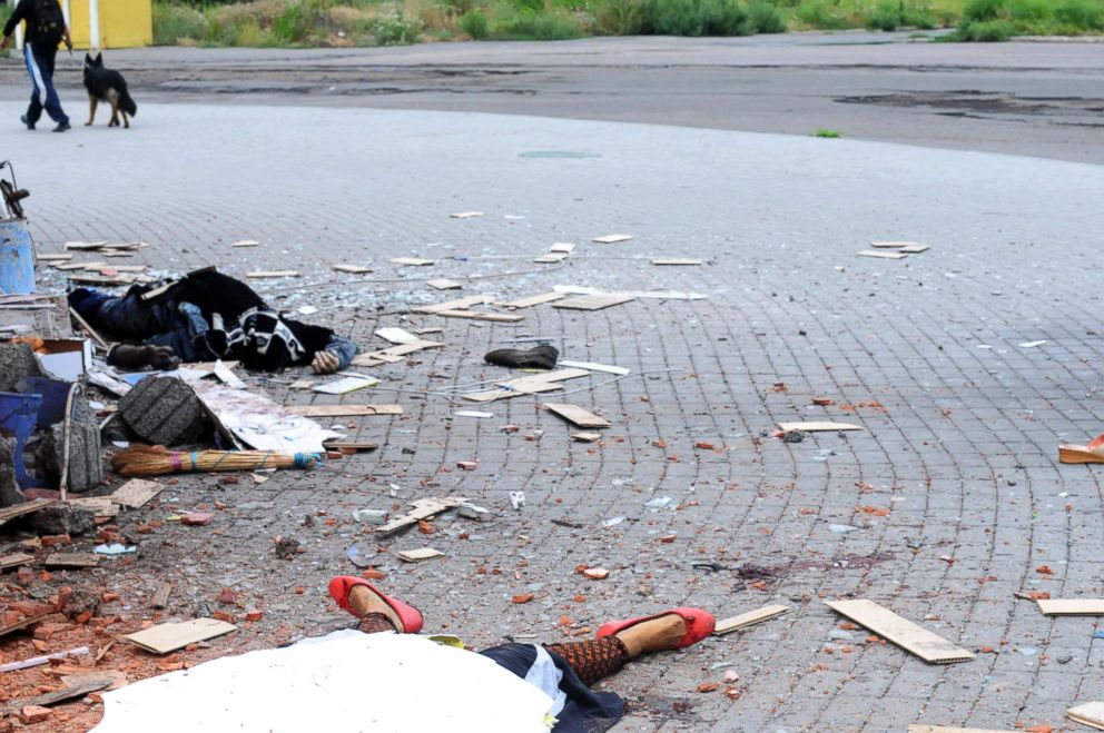 PHOTO: A couple was just killed while going to work by artillery fire in the city of Donetsk.