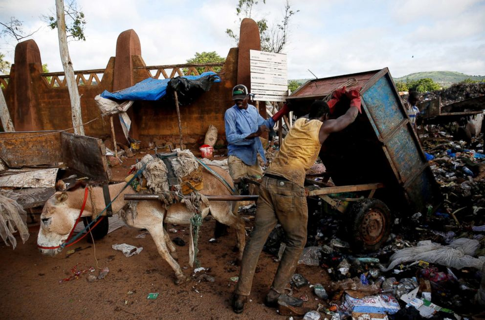 PHOTO: A waste picker unloads garbage at a waste transfer station in Bamako, Mali, Aug. 13, 2018.