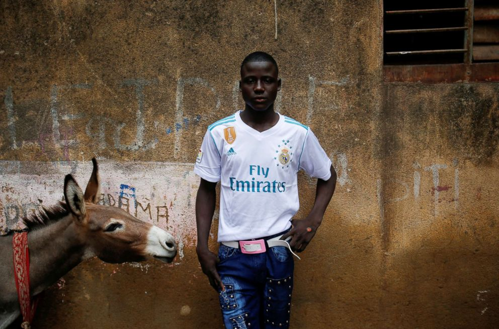 PHOTO: Salif Diabate, 18, poses for a photograph before going for a walk with his friends in Bamako, Mali, Aug. 21, 2018.