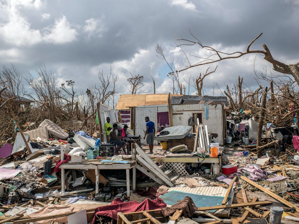 PHOTO: Survivors of Hurricane Dorian survey the wreckage of their home in Marsh Harbour, the Bahamas, on Sept. 6, 2019.