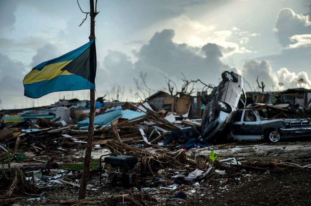 PHOTO: A Bahamas flag flies amidst the rubble left by Hurricane Dorian in Abaco, Bahamas, Sept. 16, 2019. Dorian hit the northern Bahamas on Sept. 1, with sustained winds of 185 mph, unleashing flooding that reached 25 feet in some areas.