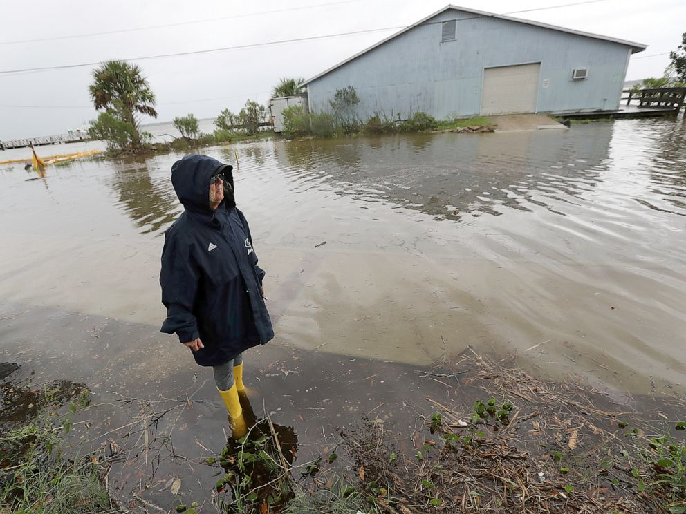 PHOTO: Cheryl Conners looks over flood waters surrounding Langs Marina near her home during Hurricane Dorian, Sept. 4, 2019, in St. Marys, Ga.