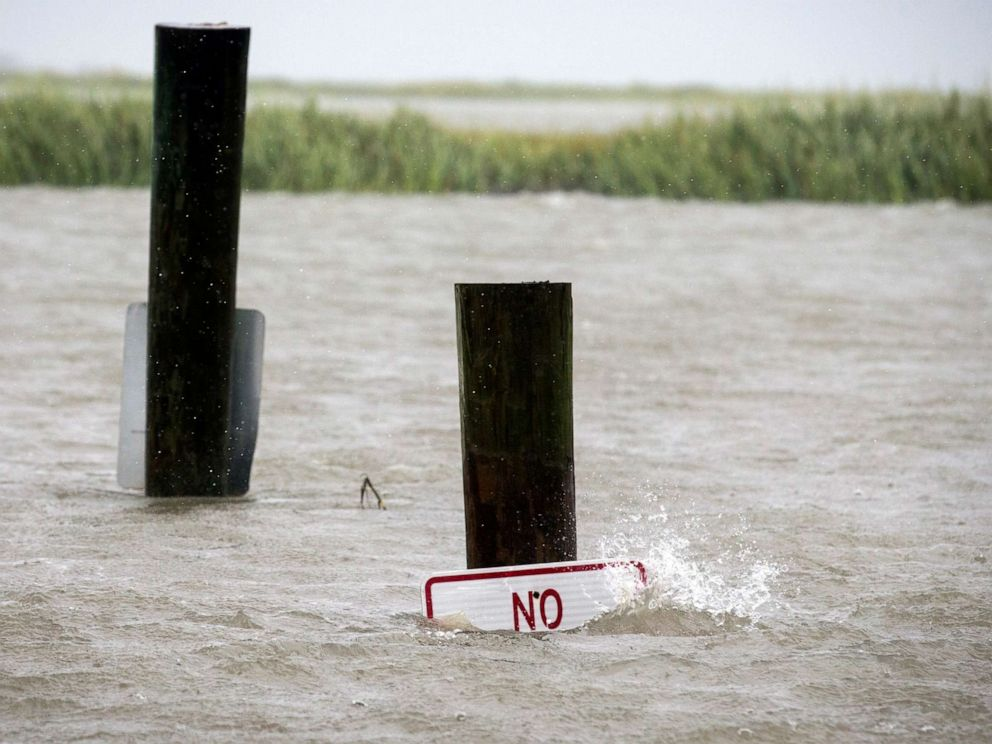 PHOTO: A sign at the Lazaretto Creek boat ramp as is nearly underwater at high tide as Hurricane Dorian makes its way up the east coast, Sept. 4, 2019, toward Tybee Island, Ga