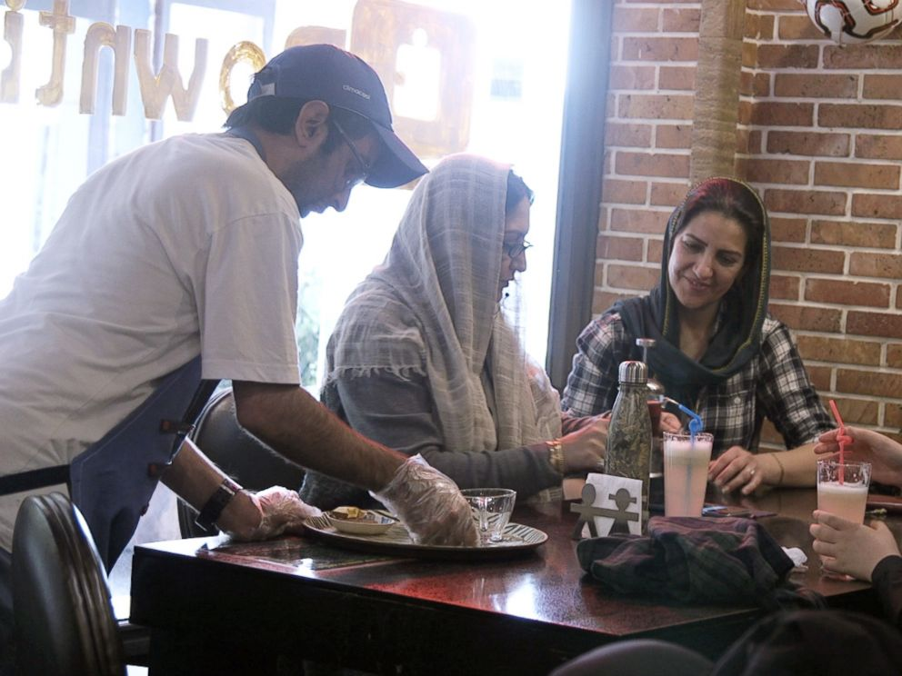 PHOTO: Staff member Mehdi Khakian serves customers at the Downtism Cafe, in Tehran, Iran, on Dec. 11, 2018.