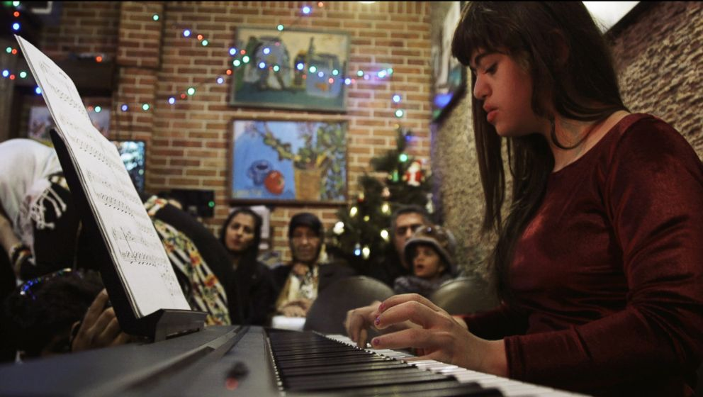 PHOTO: Parnian Hamidi, 13, a former staff member at the Downtism Cafe, in Tehran, Iran, performs at a concert held at the cafe, on Dec. 13, 2018.